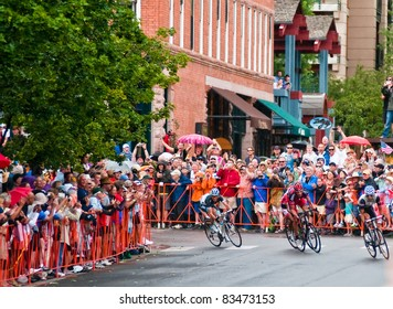ASPEN, CO - AUG. 24: A packed crowd cheers George Hincapie (C) on his final sprint to the finish winning the Queen Stage of USA Pro Cycling Challange in historic downtown Aspen, CO. on Aug 24, 2011
