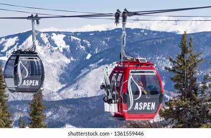 Aspen, CO / USA - April 6, 2016: Gondolas delivering skiers for the descent in Aspen.
