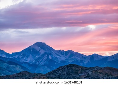 Aspen, Colorado rocky mountains colorful purple pink blue sunset twilight with Snowmass mountain peak ridge closeup