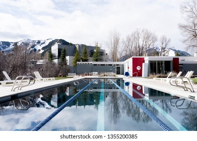 "Aspen, Colorado / USA - April 9, 2016: A view from the end of the ""Lap Pool"" located at the Aspen Meadows Resort featuring beautiful surrounding."