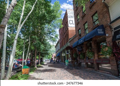 ASPEN, COLORADO, USA - JULY 14: View east along Cooper Ave in downtown Aspen on July 14, 2011. The Aspen Mountain ski area is in the background.