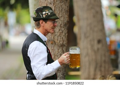 Aspen, Colorado USA September 3, 2016 Oktoberfest musicians in German Bavarian costumes and outfit drinking large beer in stein