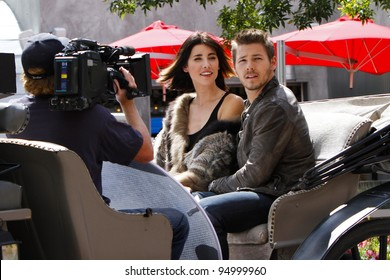 """ASPEN - SEPT 9: Scott Clifton and Jacqueline MacInnes Wood film the CBS daytime drama """"The Bold and the Beautiful"""" on location in Aspen, CO on September 9, 2011."""