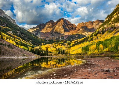 The Aspen trees glow yellow at Maroon Bells.