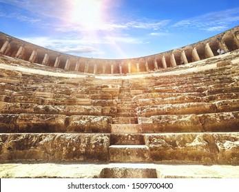 Aspendos Amphitheater close-up inside in the summertime with sunshine, Turkey, Serik.