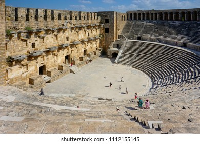 Aspendos Theater, Antalya / Turkey - June 10, 2018 - Tourists are visiting the Aspendos Theater: one of the largest and the best preserved examples of Roman theater in Antalya