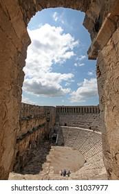 Aspendos theater through an arch