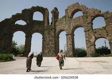 ASPENDOS, TURKEY -april 13, 2009: Local turkish women walk by aqueduct of Aspendos Ancient City, Antalya