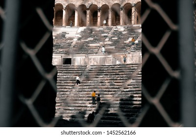 Aspendos, Turkey - April 30, 2019: Through the bars view of the amphitheater in the ancient city of Aspendos, near Antalya