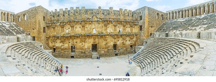 ASPENDOS, TURKEY - MAY 8, 2017: The Aspendos amphitheater is the best place to enjoy the archaeological museum and watch the great example of the ancient architecture, on May 8 in Aspendos.