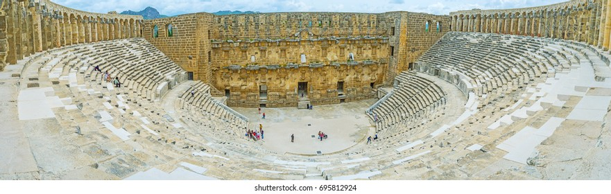 ASPENDOS, TURKEY - MAY 8, 2017: The amphitheater is the main object of Aspendos archaeological site and the best place to enjoy ancient Greco-Roman architecture, on May 8 in Aspendos.