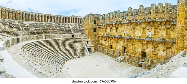 ASPENDOS, TURKEY - MAY 8, 2017: Aspendos archaeological site is important part of the tourist routes, its amphitheater is nice place to discover ancient Greco-Roman architecture, on May 8 in Aspendos.