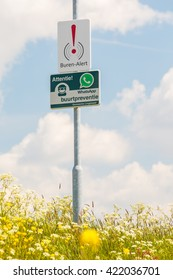 ASPEREN, THE NETHERLANDS - MAY 4, 2016: Dutch neighborhood watch sign on an entrance road in the village of Asperen, The Netherlands