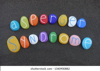 Asperger syndrome, developmental disorder of AS, illness name composed with multi colored stones over black volcanic sand