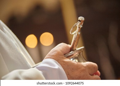 Asperges: liturgical object used by Catholic Christian priests to bless faithful believers by throwing holy water drops on them.