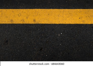 Asphalt as abstract background Street line Yellow black