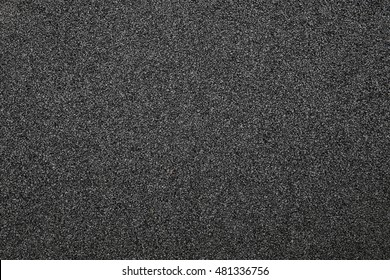 Asphalt background texture with some fine grain in it. Black abrasive material for wallpaper and for abstract backgrounds