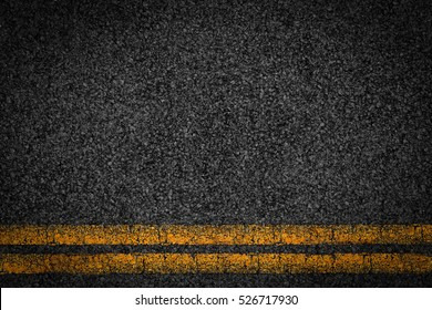 Asphalt background texture with some fine grain with Yellow Stripe
