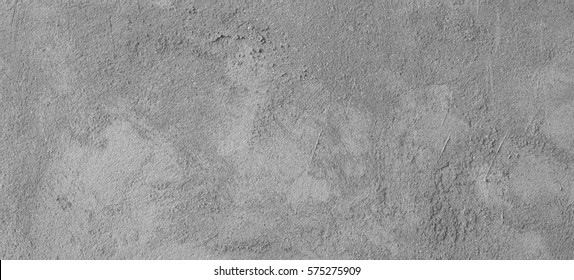 Asphalt close-up, wet concrete wall texture. Raw plaster wall background.