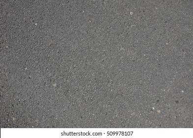 Asphalt concrete roadway pavement surface. Grey flat texture for 3D work, textured backround