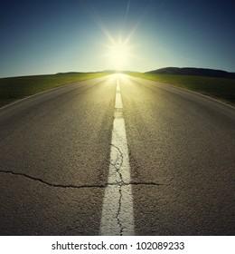 asphalt of country road in backlight