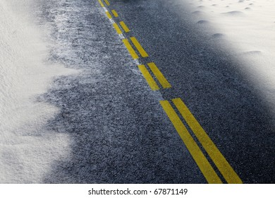 asphalt detail of road with snow at winter time