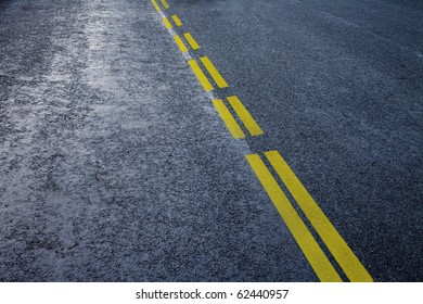 asphalt detail with yelow line