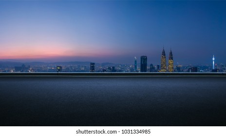 Asphalt empty road side with   Kuala Lumpur city skyline background . Night scene .