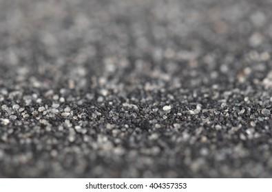 Asphalt felt texture, for using on a roof or floor, selective focus