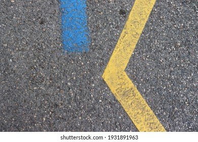 Asphalt floor with blue and yellow lines