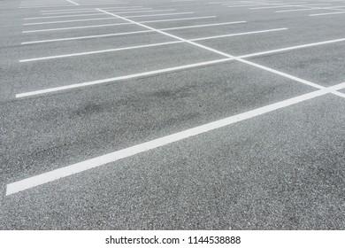 Asphalt Floor with parking lot at city center, Vacant Parking Lot, Parking lane painting on floor, copy space