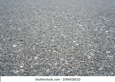 Asphalt grey grainy road, Surface rough of granular street, Texture background, Perspective