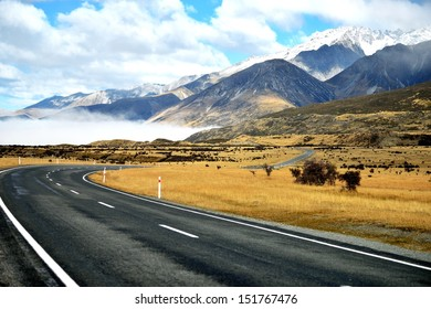 asphalt  highway curve road to mountain cook New Zealand with cloud and sky