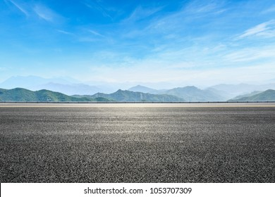 asphalt highway and hill landscape under the blue sky