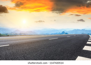 Asphalt highway and mountain natural landscape at sunrise