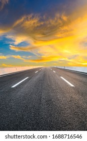Asphalt highway road and sky sunset clouds landscape.