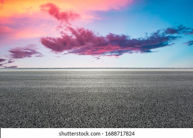 Asphalt highway road and sky sunset clouds landscape.