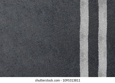 Asphalt highway texture with two white stripes.