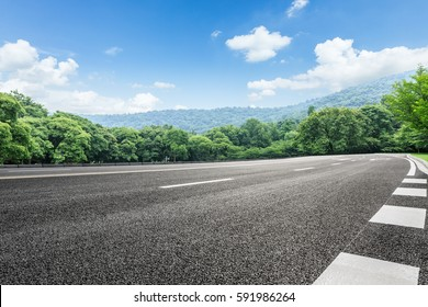Asphalt highways and mountains under the blue sky