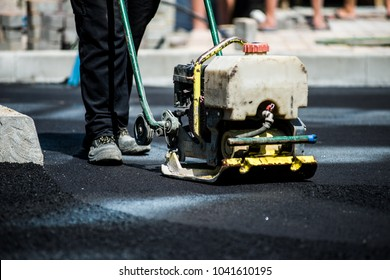 asphalt laying by workers