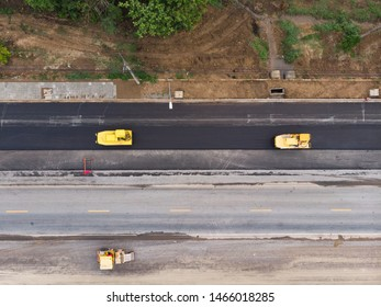 Asphalt machine and steamroller operator job at new road construction site