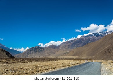 Asphalt mountain road in the Himalayas on a Sunny summer day, Nepal.