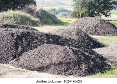 asphalt on gravel pile