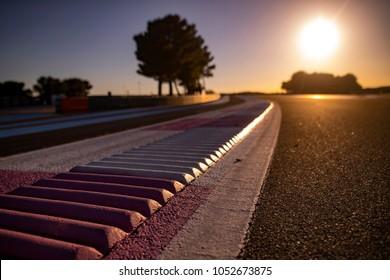 Asphalt on race track with curbs