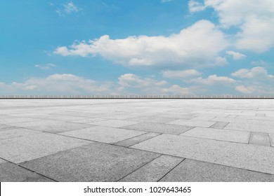 Asphalt pavements and square floor tiles under the blue sky and