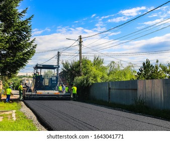 asphalt paver machine. Construction machines and equipment for new road with support from the European Union structural funds. Targoviste, Romania, 2020.