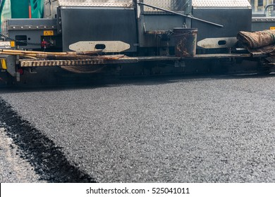 Asphalt paver machine during road construction, Road construction and repairing works