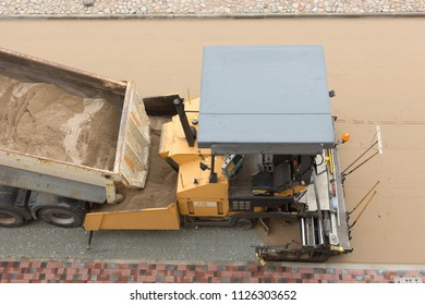 asphalt paving machine from above working on street