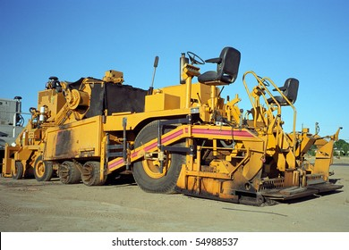An asphalt paving machine is ready to construct roads