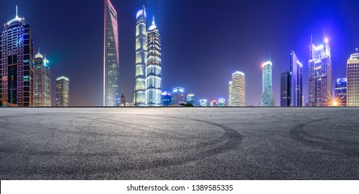 Asphalt race track and modern skyline and buildings in Shanghai at night,panoramic view